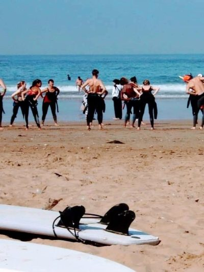 Surfers warming up for the surf session in Tamraght Agadir Morocco